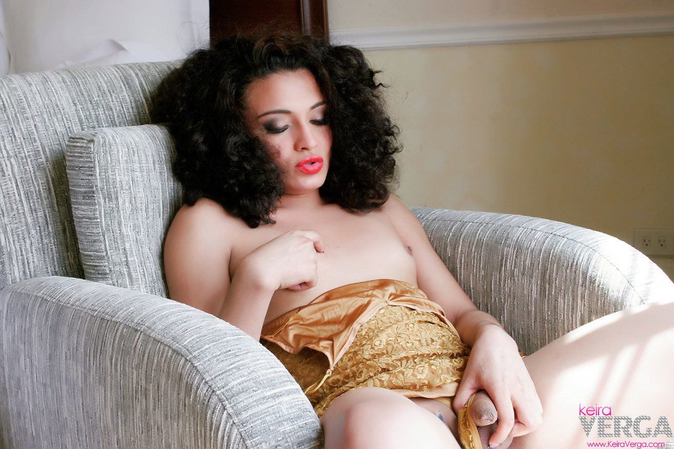 Brunette T-Girl With A Racy Face Flashes Us Her Enormous Shec